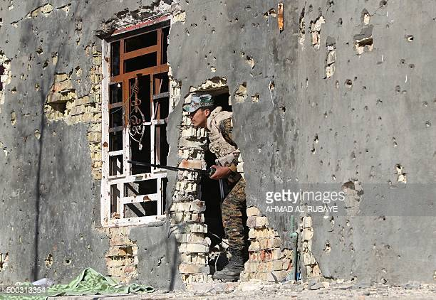 An Iraqi security forces member takes combat position in the rural town of Husayba in the Euphrates Valley seven kilometres east of Ramadi on...