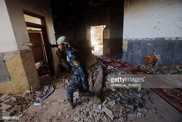 An Iraqi security forces member walks with a Rocket Propelled Grenade in the rural town of Husayba in the Euphrates Valley seven kilometres east of...
