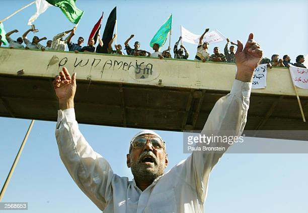 An Iraqi Shia man yells for the release of detained Iraqi Shia Imam Mo'ayed alKhezragi at the AlAbayaa mosque during a protest October 7 2003 in...