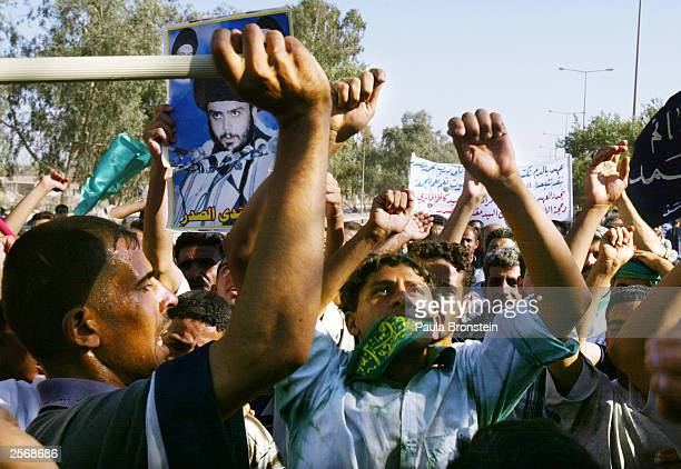 An Iraqi Shia men rally for the release of detained Iraqi Shia Imam Mo'ayed alKhezragi at the AlAbayaa mosque during a protest in Baghdad on October...