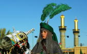 An Iraqi Shiite boy reenacts the battle of Karbala on January 27 2007 in Karbala Iraq Millions of Shiite Muslims pilgrimage to the city of holy...