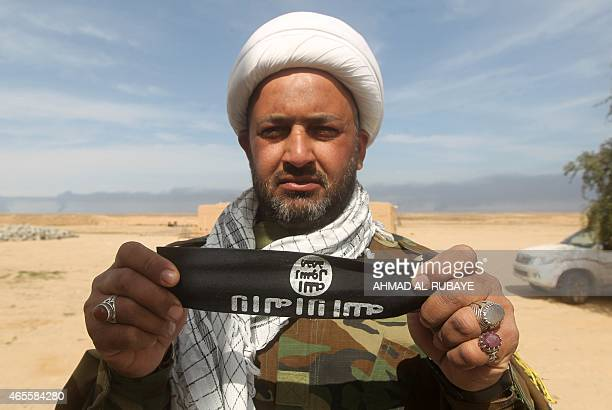An Iraqi Shiite fighter and member of Iraq's Popular Mobilisation units supporting Iraqi government forces in the battle against the Islamic State...