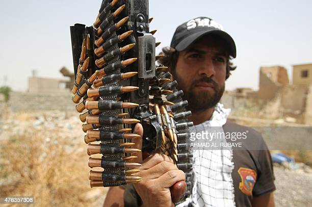 An Iraqi Shiite fighter from the Popular Mobilisation force holds his weapon as he keeps position during a battle against jihadists from the Islamic...