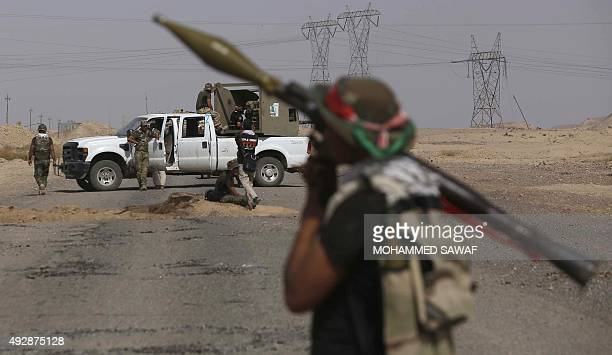 An Iraqi Shiite fighter from the Popular Mobilisation units fighting alongside Iraqi government forces holds a Rocket Propelled Grenade in the town...