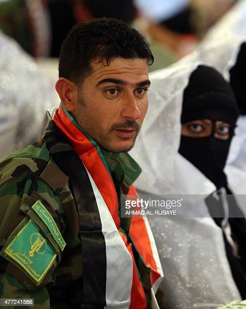 An Iraqi Shiite fighter from the popular mobilization units who are supporting Iraqi government forces in the battle against Islamic State group...