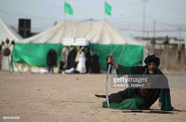 An Iraqi Shiite man performs a reenactment of the Battle of Karbala as part of the Ashura commemorations on October 24 2015 in the capital Baghdad...