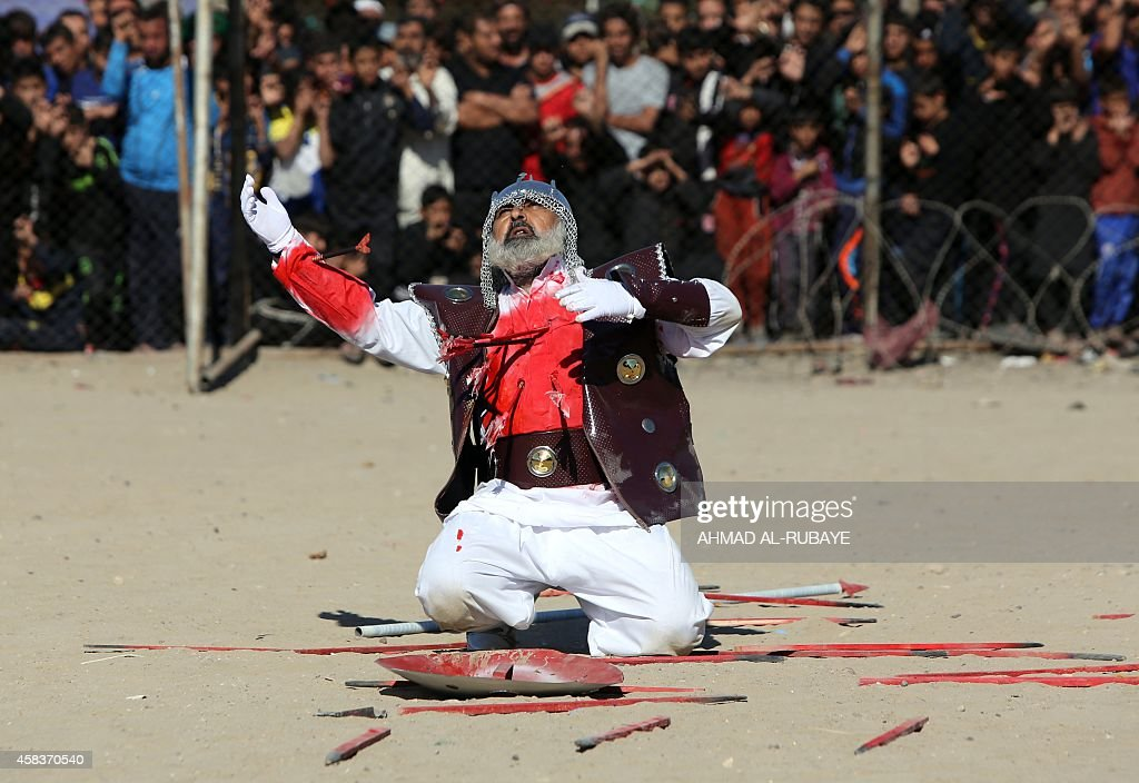 An Iraqi Shiite man performs during the reenactment of the Battle of Karbala as part of the Ashura commemorations on November 4 2014 in the capital...