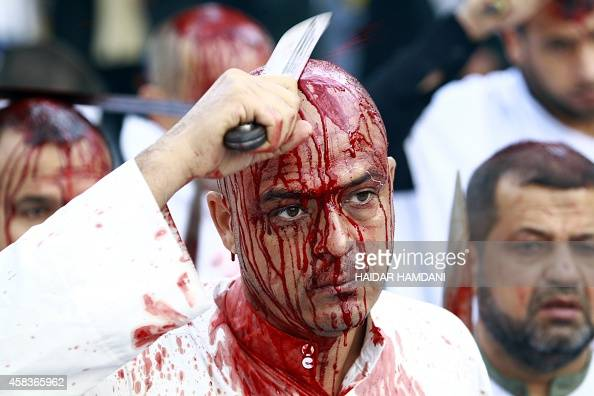 An Iraqi Shiite man takes part in a selfflagellation procession during the Ashura commemorations that mark the killing of Imam Hussein one of Shiite...