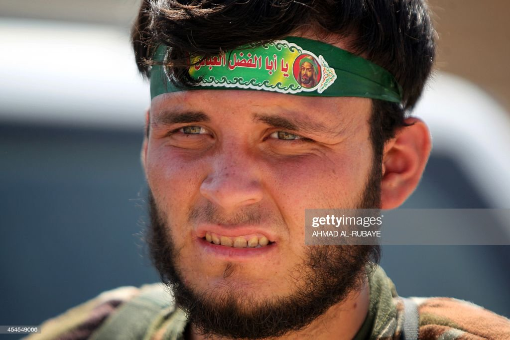 An Iraqi Shiite militia fighter looks on near Amerli on September 3 after pushing back Islamic State militants Amerli was besieged when ISled...