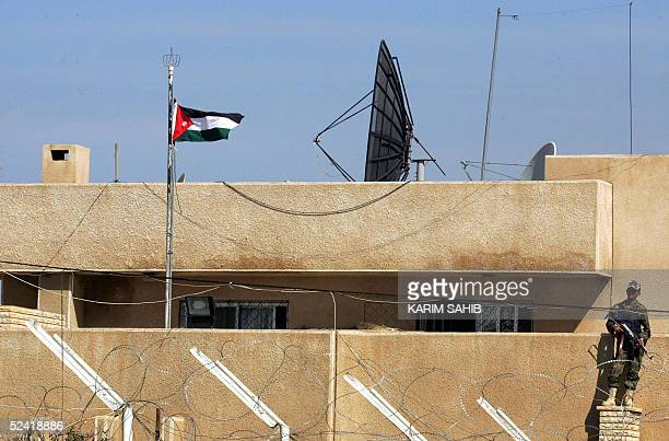 An Iraqi soldier guards the Jordanian embassy a day after protesters burnt the Jordanian flag 15 March 2005 in Baghdad Iraqis mainly Shiite Muslims...