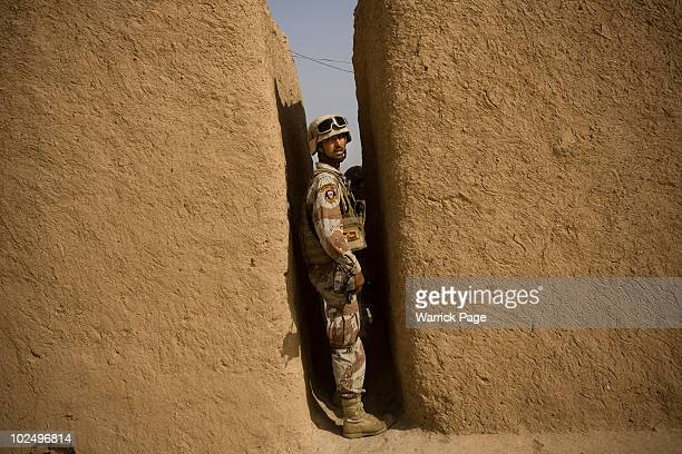 An Iraqi soldier searches a village during a clearance operation on June 12 2010 in Ali Juma Diyala Province Iraq Iraq faces multiple challenges in...