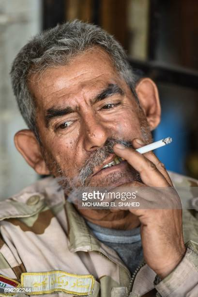 An Iraqi soldier smokes a cigarette in Mosul's western AlShifa district on June 15 during the ongoing offensive by Iraqi forces to retake the city...