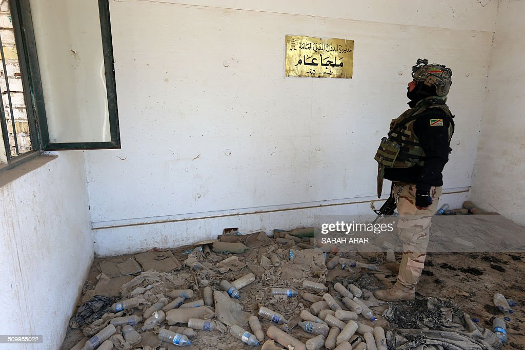 An Iraqi soldier visits the bombed shelter of Ameriya in Baghdad on February 13, 2016. The shelter was bombed by the allied forces during the 1991 Gulf War. Approximately 400 Iraqis perished in the attack. / AFP / SABAH ARAR