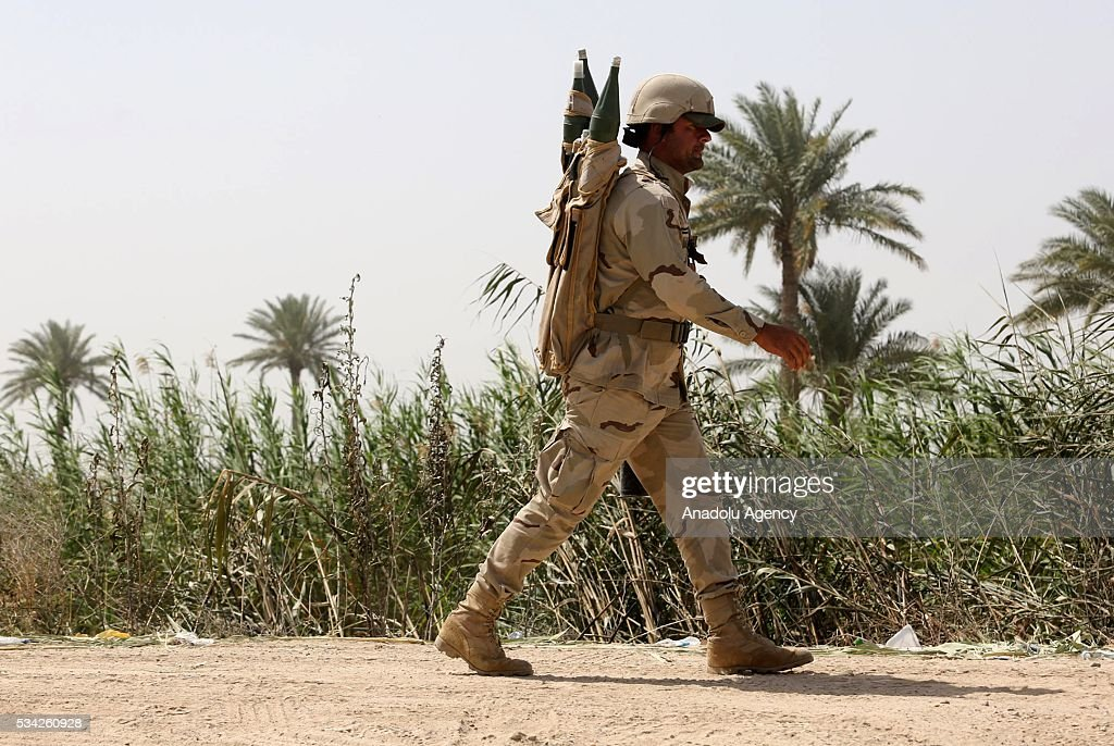 An Iraqi soldier walks on the road between Felluce and Garma towns as they carry operations to rescue Felluce town from Daesh terrorists in Anbar, Iraq on May 25, 2016.