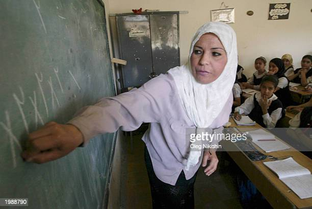 An Iraqi teacher Teaches to School Girls
