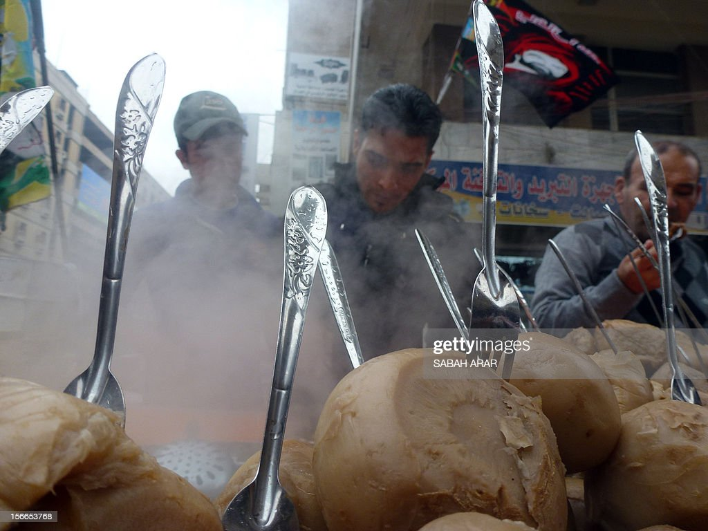 An Iraqi vendor sells Shalgham, Syrian turnip, on a street in the capital Baghdad on November 18, 2012. The price of the turnip doubled over the past year due to the ongoing conflict in Syria, reaching a new high of 1000 Iraqi Dinars (0.85 US Dollars), a vendor said.