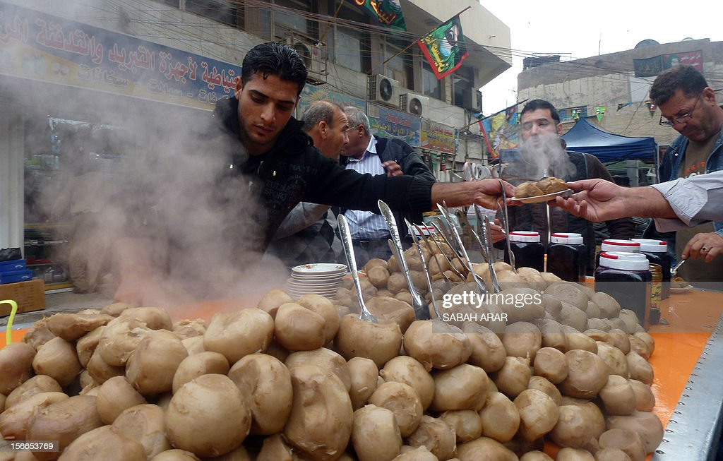 An Iraqi vendor sells Shalgham, Syrian turnip, on a street in the capital Baghdad on November 18, 2012. The price of the turnip doubled over the past year due to the ongoing conflict in Syria, reaching a new high of 1000 Iraqi Dinars (0.85 US Dollars), a vendor said. AFP PHOTO / SABAH ARAR