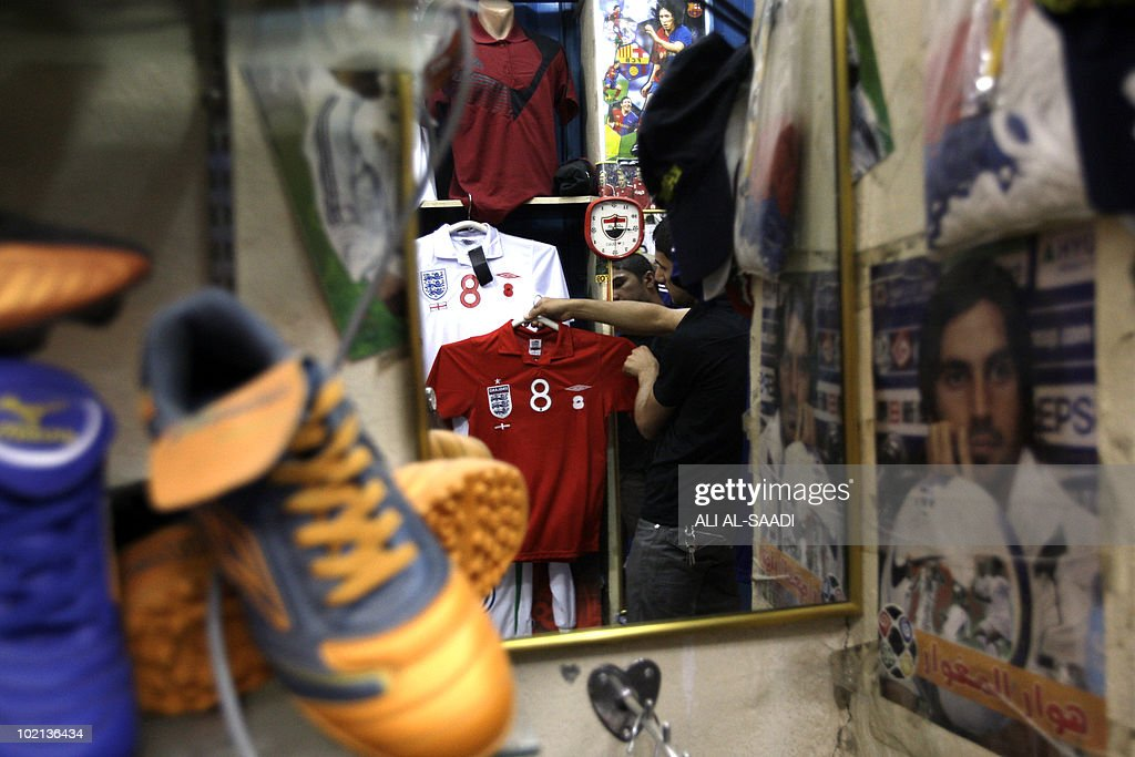 An Iraqi vendor shows off a soccer shirt as the war torn nation follows the World Cup 2010 taking place in South Africa, on June 16, 2010, in central Baghdad.