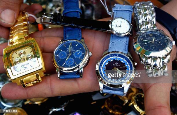 An Iraqi watchseller shows fake watches including Rolex which is about $15 November 5 2004 in Baghdad Iraq Most of the goods sold on the Iraqi market...