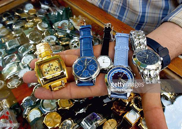 An Iraqi watchseller shows his fake watches including Rolex which is about $15 November 5 2004 in Baghdad Iraq Most of the goods sold on the Iraqi...