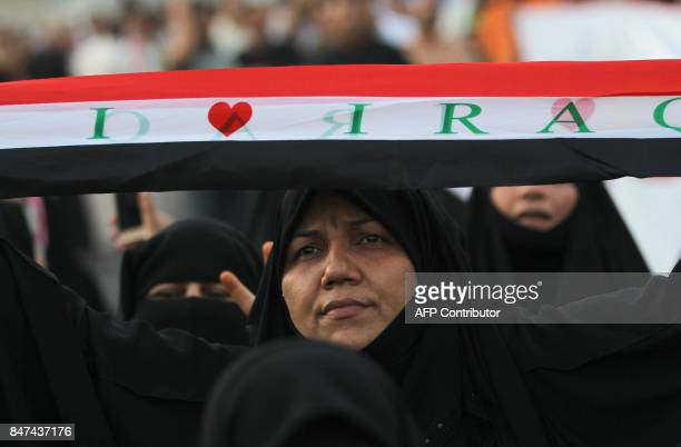 TOPSHOT An Iraqi woman a follower of cleric Moqtada alSadr takes part in a demonstration against corruption in Iraq and demanding reform and a change...