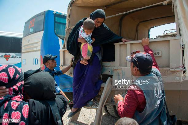 An Iraqi woman arrives at a camp for internally displaced people in Hammam alAlil on May 14 after fleeing west Mosul due to the government forces...