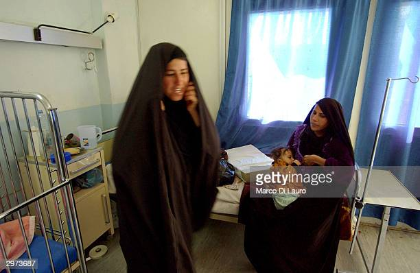 SAMAWA IRAQ FEBRUARY 12 An Iraqi woman breastfeeds her child at the Samawa Maternity and Children Hospital 170 miles south of Baghdad February 12...