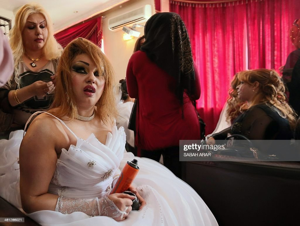 An Iraqi woman get ready to take part in the first beauty contest hosted by 'Ghassan Life Cosmetics' company for both male and female competitors in Baghdad on March 29, 2014. More than 40 men and 120 women participated in the competition from all over Iraq.