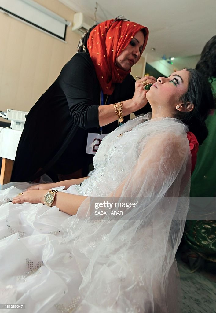 An Iraqi woman has make-up applied before taking part in the first beauty contest hosted by 'Ghassan Life Cosmetics' company for both male and female competitors in Baghdad on March 29, 2014. More than 40 men and 120 women participated in the competition from all over Iraq.