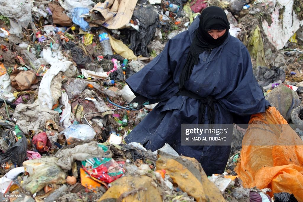 An Iraqi woman searches for plastic bottles in a garbage dump on the outskirts of Baghdad's impoverished district of Sadr City, January 30, 2013. Around a quarter of Iraq's population are estimated by the country's Planning Ministry to live in poverty, and many survive in vast refuge dumps where they search for subsistence, either via using disposed goods or finding items that can be handed to recycling plants for money.