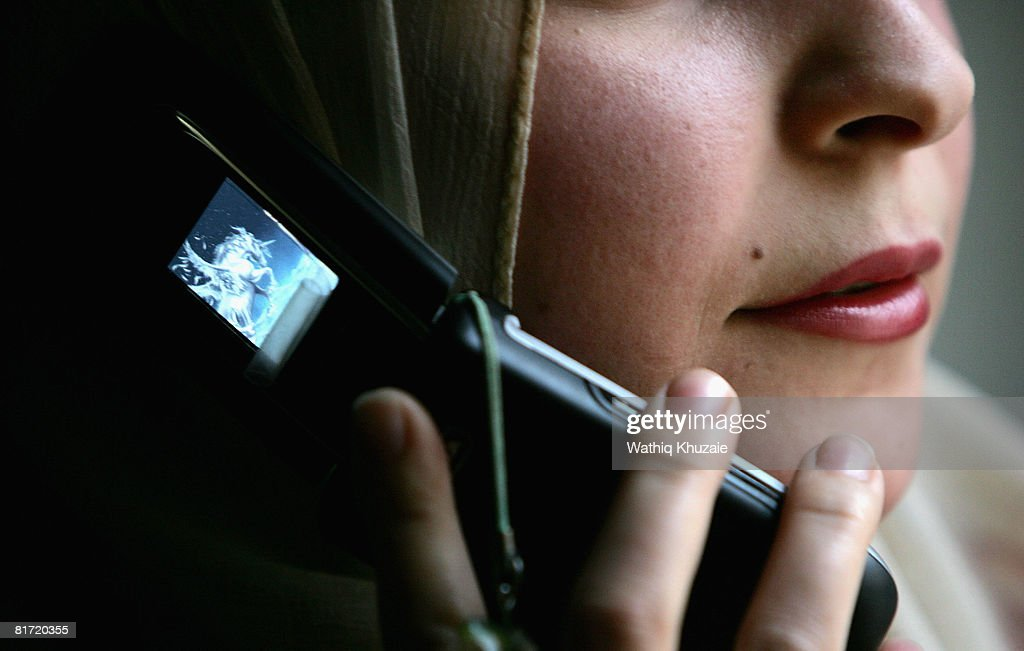 An Iraqi woman uses a mobile phone on June 26, 2008 in Baghdad, Iraq. The war-damaged aging landline telephone infrastructure means Iraqis are increasingly more dependent on mobile phones in daily life and business.