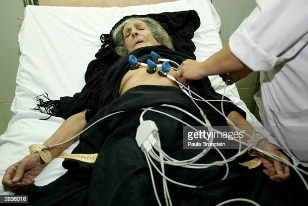 An Iraqi woman with heart disease gets an Electro Cardiograph test while she lies in the emergency room at AlYarmouk hospital October 23 2003 in...