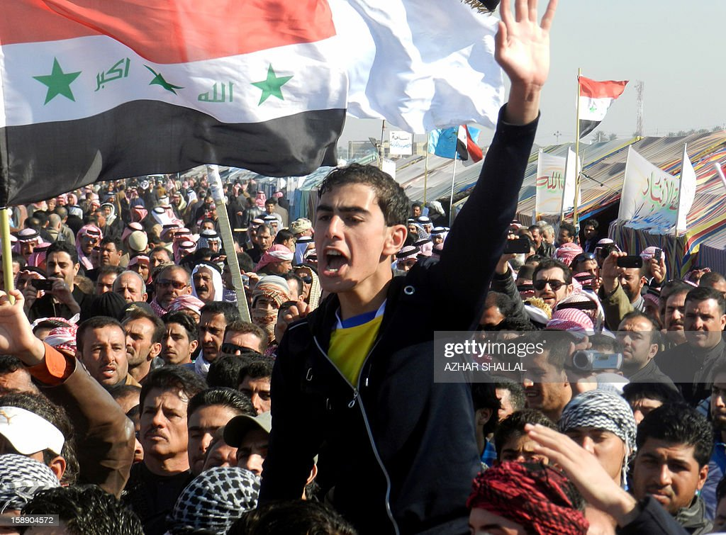 An Iraqi-Sunni protestor shouts slogans alongside fellow Sunni prostestors and Shiite demonstrators from the Karbala provinces and the Baghdad Shiite suburb of Sadr City during a demonstration in the western city of Ramadi calling for the release of prisoners and the resignation of the Iraqi Shiite premier on January 3, 2013. Officials sought to head off the demonstrations against Iraqi Prime Minister, Nuri al Malaki, by beginning a mass release of female prisoners, a key demand of Sunni Arab protesters angered by what they allege is the misuse of anti-terror legislation by the Shiite-led authorities to target their minority community. AFP PHOTO / AZHAR SHALLAL