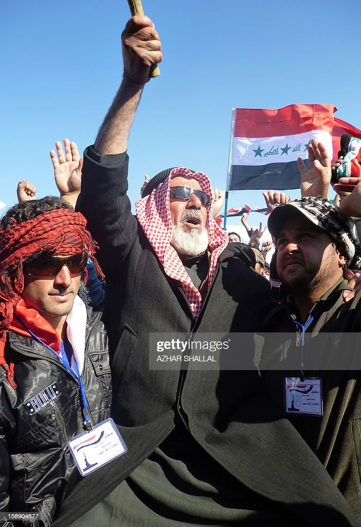 An Iraqi-Sunni protestor shouts slogans alongside fellow Sunni prostestors and Shiite demonstrators from the Karbala provinces and the Baghdad Shiite suburb of Sadr City during a demonstration in the western city of Ramadi calling for the release of prisoners and the resignation of the Iraqi Shiite premier on January 3, 2013. Officials sought to head off the demonstrations against Iraqi Prime Minister, Nuri al Malaki, by beginning a mass release of female prisoners, a key demand of Sunni Arab protesters angered by what they allege is the misuse of anti-terror legislation by the Shiite-led authorities to target their minority community.