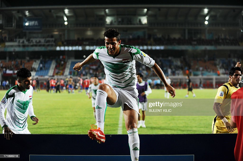 An Iraq's player jumps to his supporters as the team celebrates its victory over Chile during a group stage football match between Iraq and Chile at the FIFA Under 20 World Cup at Akdeniz University Stadium in Antalya on June 29, 2013.