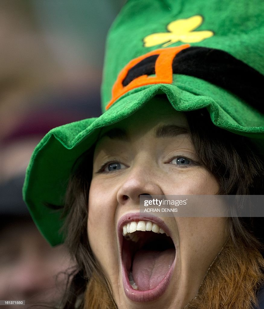An Ireland fan cheers as the teams walk onto the field during the Six Nations international rugby union match between Ireland and England at the Aviva Stadium in Dublin on February 10, 2013. England won the game 12-6.
