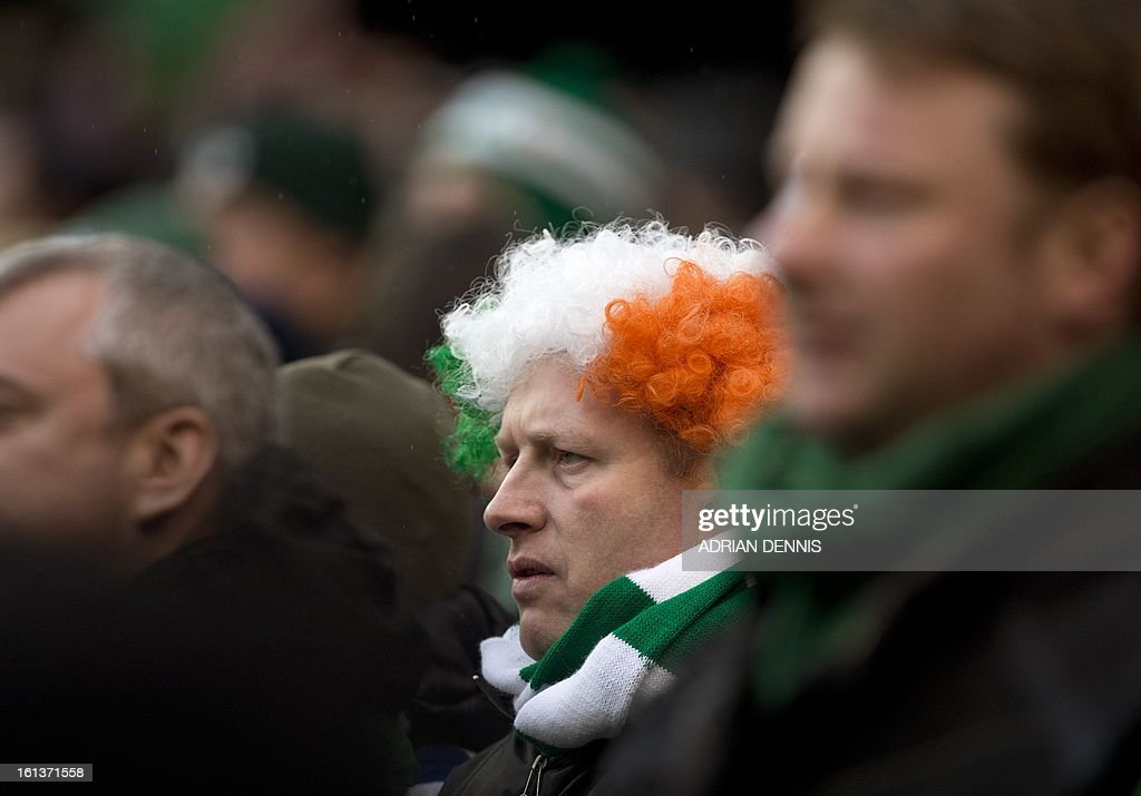 An Ireland fan watches the game during the Six Nations international rugby union match between Ireland and England at the Aviva Stadium in Dublin on February 10, 2013. England won the game 12-6.