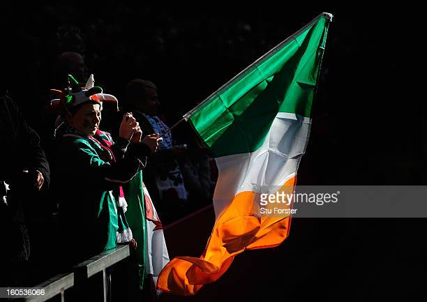 An Ireland fan waves a flag before the RBS Six Nations game between Wales and Ireland at the Millennium Stadium in Cardiff Wales