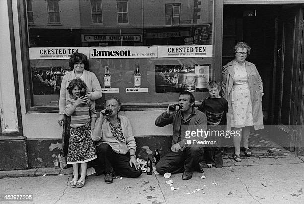 An Irish gypsy family enjoy a drink outside a pub during the Fleadh Cheoil a traditional Irish music festival in Listowel County Kerry Ireland 1981