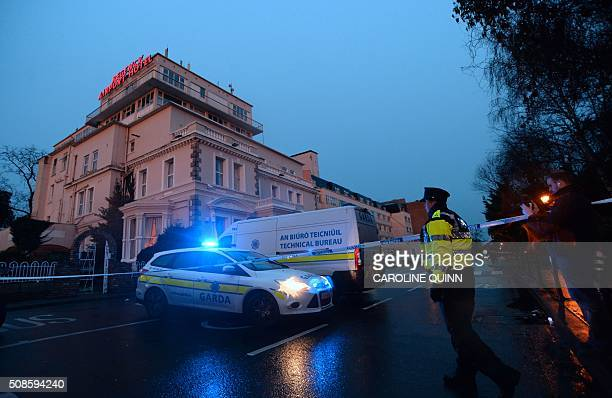 An Irish police officer stands at the police cordon sealing off the Regency Airport Hotel in Dublin on February 5 2016 following a shooting incident...