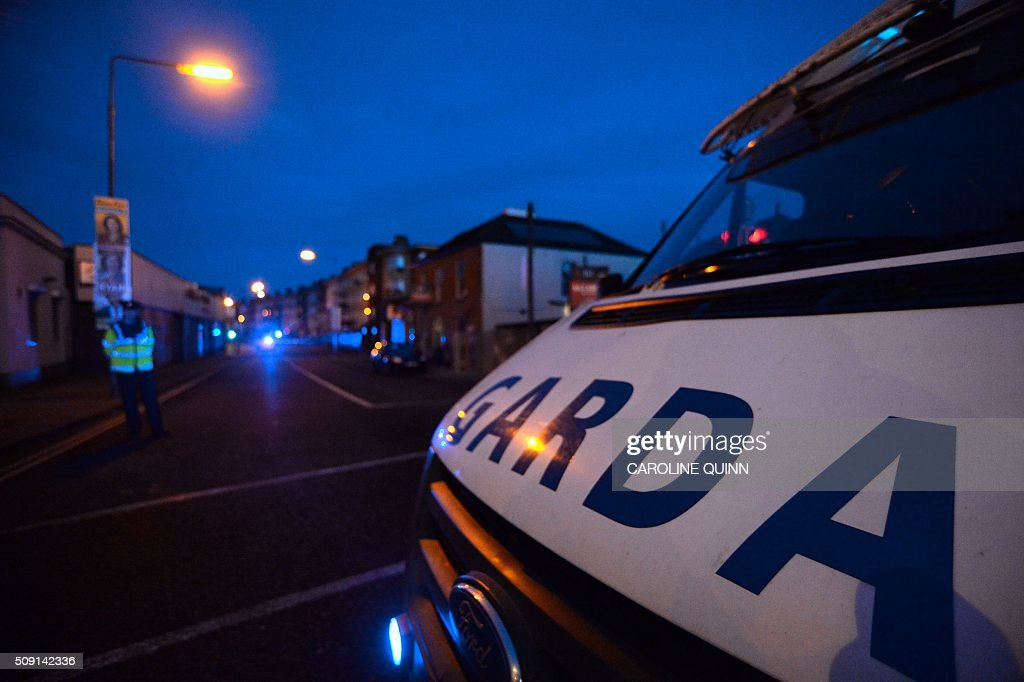 An Irish police (Gardai) van is parked close to the scene of a fatal shooting at a residential address in Dublin on February 9, 2016. A man was shot dead in Dublin on February 8, Irish police said, in a suspected gangland reprisal attack for a fatal shooting at a boxing event last week. The victim was named by Ireland's national broadcaster RTE as Eddie Hutch, brother of the north Dublin crime figure known as 'The Monk' and the uncle of Irish criminal Gary Hutch, whose 2015 killing in Spain is thought to have begun the feud. / AFP / CAROLINE QUINN