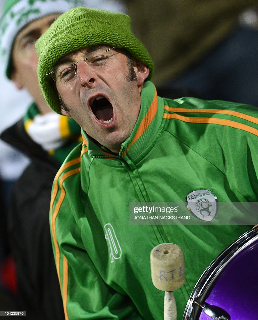 An Irish supporter cheers his team during the FIFA 2014 World Cup group C qualifying football match Faroe Islands vs Republic of Ireland at the Torsvollur stadium in Torshavn on October 16, 2012.