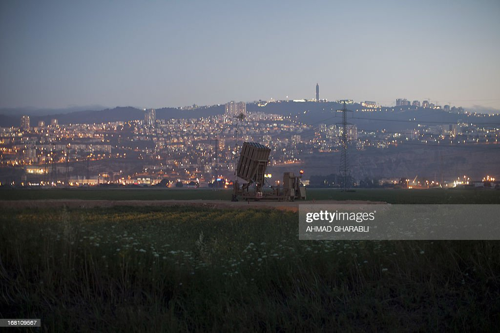 An 'Iron Dome' short-range missile defence system is pictured near the northern Israeli city of Haifa on May 5, 2013. Israel carried out a pre-dawn air strike near Damascus, targeting Iranian missiles destined for Lebanon's Hezbollah in the second such raid on Syria in three days, a senior Israeli source said. AFP PHOTO/AHMAD GHARABLI