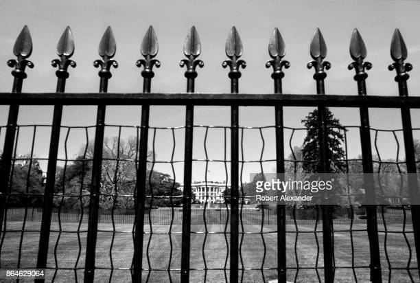An iron fence surrounds the White House fence in Washington DC in 1977