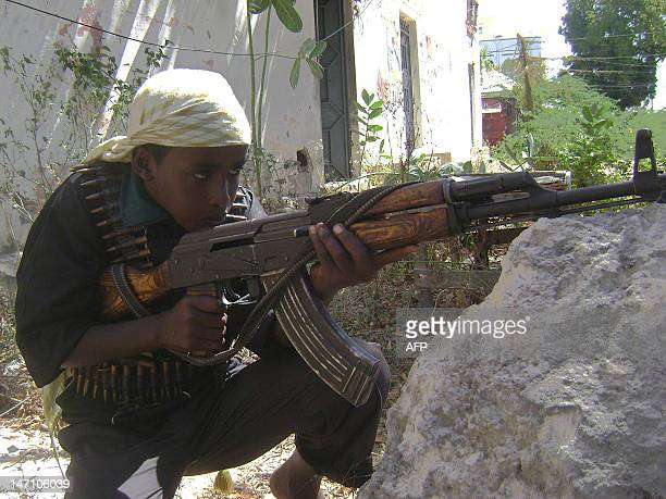An Islamic fighter aims his gun during a training exercise in Mogadishu in Somalia on January 12 2009 Ethiopian forces pulled out on January 13 from...