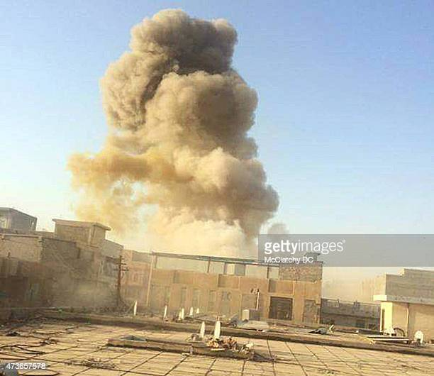 An Islamic State car bomb explodes at the gate of a government building near the provincial governor's compound in Ramadi Iraq on Saturday May 16...