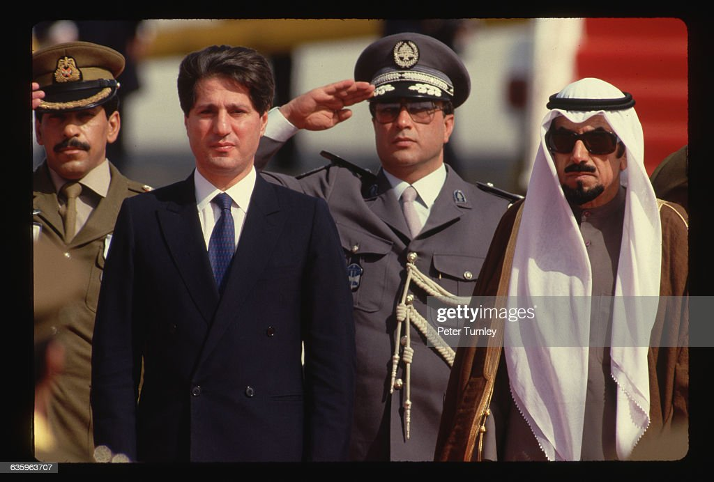 An Islamic Summit was held in Kuwait in 1987. Lebanese President, <a gi-track='captionPersonalityLinkClicked' href=/galleries/search?phrase=Amin+Gemayel&family=editorial&specificpeople=707662 ng-click='$event.stopPropagation()'>Amin Gemayel</a>, and Kuwaiti Emir, Jabar Al-Ahmed Al-Sabah, stand with military officials.