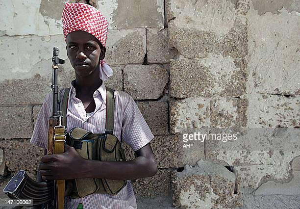 An Islamist militant loyal to newly elected President Shaikh Sharif Sheikh Ahmed takes up position at a roadblock in Mogadishu February 19 2009...