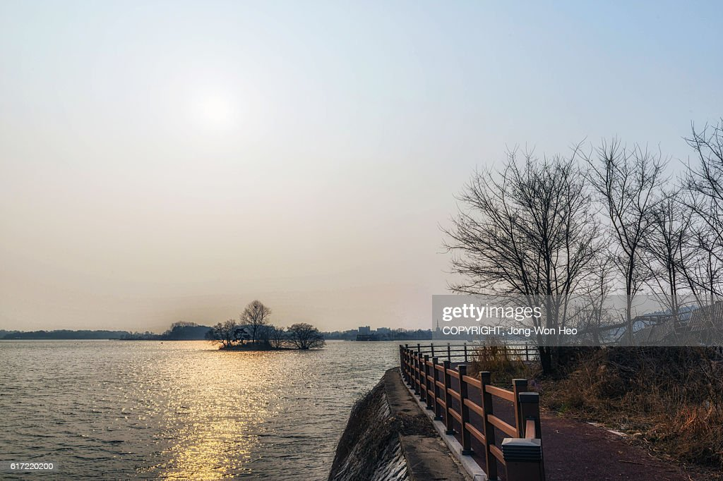 An island in the lake under the sun : Stock Photo