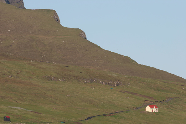 An isolated house on a hillside close to the village of Midvágur a renowned location for the Faroe Islands whaling industry and near to the Faroe...